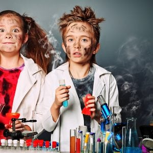 Two children making science experiments
